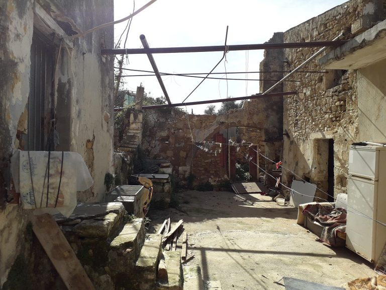 stone house for sale in chania yard