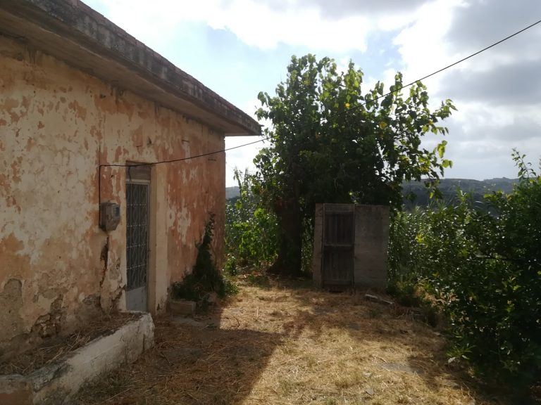 stone house for sale in chania trees