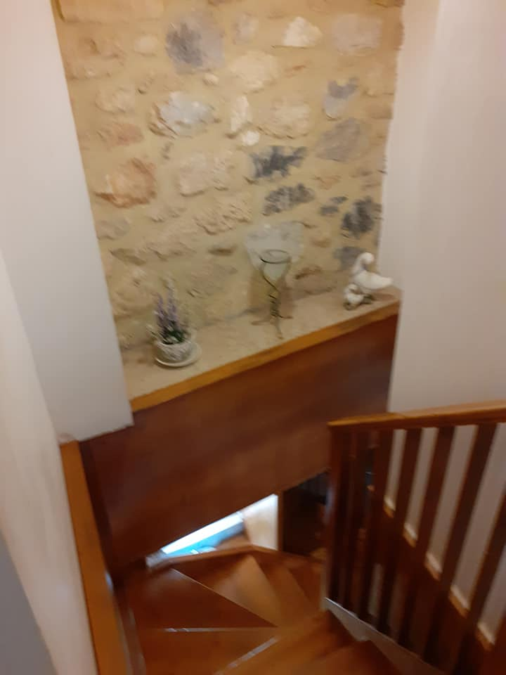 Stone house for sale in Pigi Rethymnon Crete wooden staircase RH015